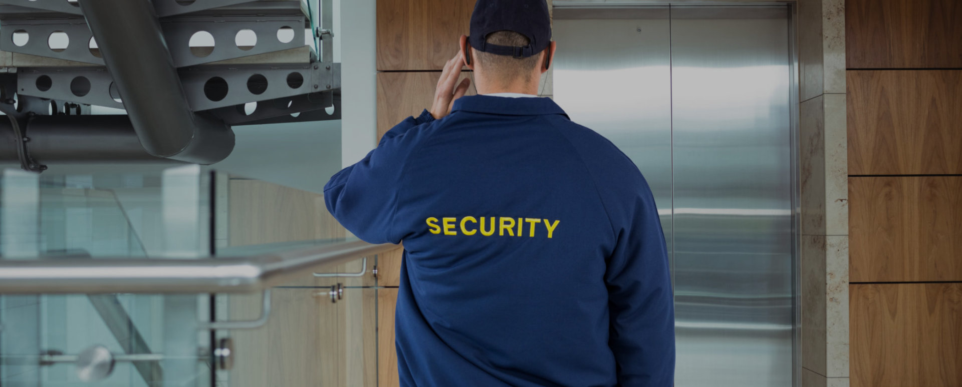 security personnel in front of an elevator